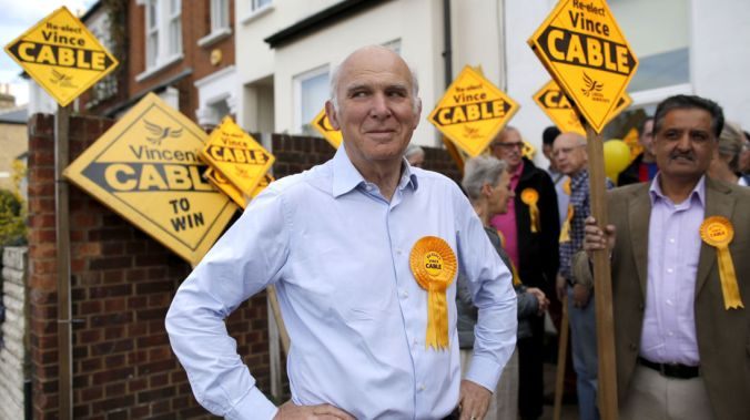 Liberal Democrat candidate for Twickenham Vince Cable waits for party leader Nick Clegg to arrive for campaigning in London