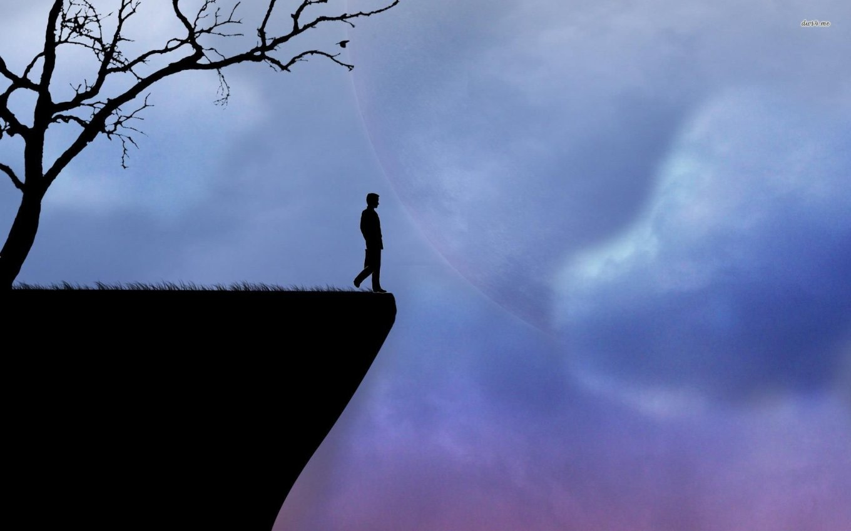 silhouette-cliff-man-tree