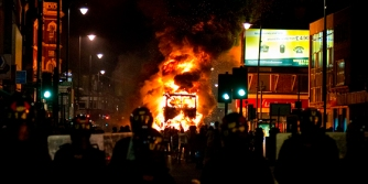 A-bus-burns-in-the-London-riots-of-2011