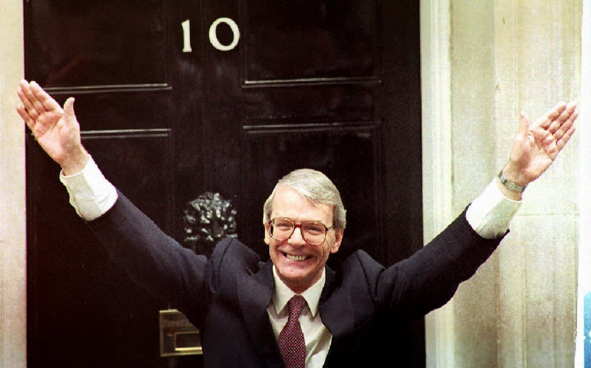 Britain's Prime Minister John Major waves to the c