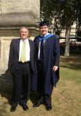 My dad and me at my graduation